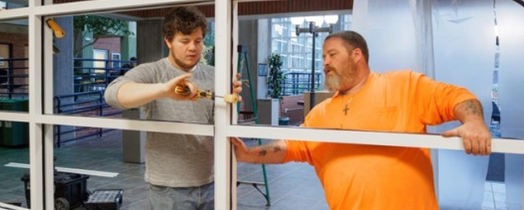 men painting windows of CARE space