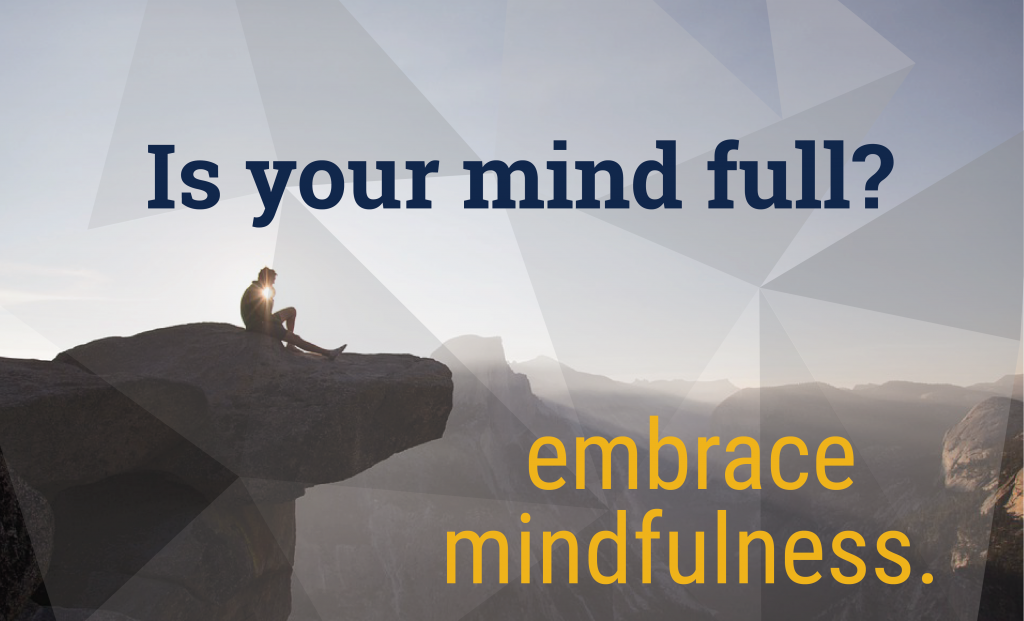 man looking over mountains with text is your mind full? embrace mindfulness.